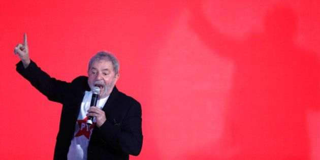 Brazil's former President Luiz Inacio Lula da Silva speaks to supporters at the Workers Party national...