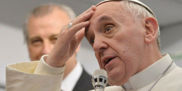 Pope Francis speaks during a news conference aboard the papal flight on its way back from Brazil, Monday,...