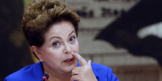 Brazil's President Dilma Rousseff, who is running for re-election with the Workers Party, PT, speaks...