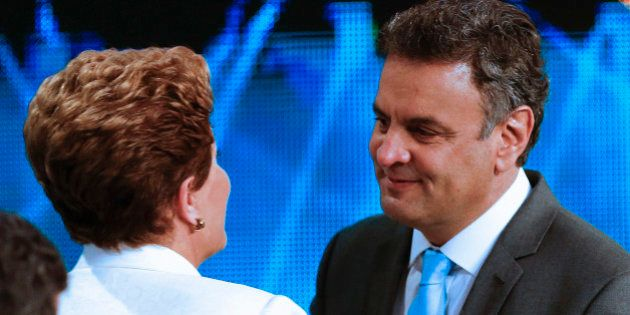 Aecio Neves, presidential candidate of the Brazilian Social Democracy Party, PSDB, right, greets Brazil's...