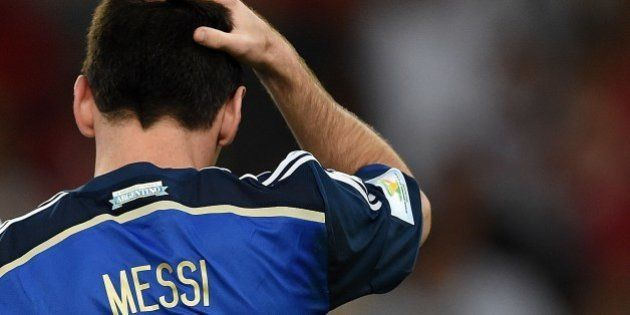 Argentina's forward and captain Lionel Messi reacts after his team lost the 2014 FIFA World Cup final...