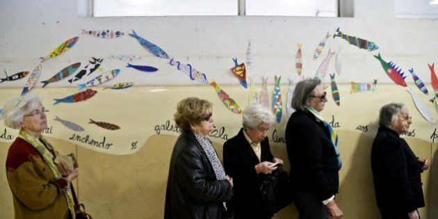 Locals wait their turn to vote in the European Parliament elections on May 25, 2014 at a polling station...