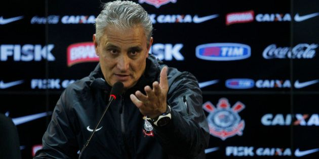 SAO PAULO, BRAZIL - JULY 16: Tite, coach of Corinthians looks on during a press conference after a training...
