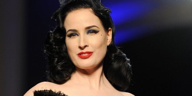PARIS, FRANCE - JANUARY 22: Model Dita Von Teese walks the runway during Jean Paul Gaultier show as part...