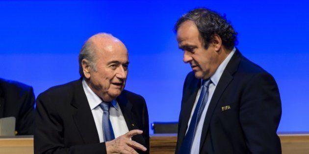 FIFA president Joseph Blatter talks to UEFA president Michel Platini during the 64th FIFA congress on...