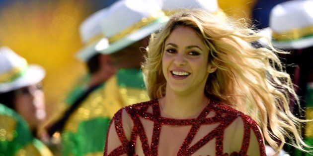 Colombian singer Shakira performs during a closing ceremony ahead of the final football match between...