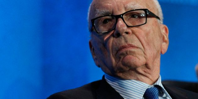 Rupert Murdoch, chairman and chief executive officer of News Corp., listens at the annual Milken Institute...