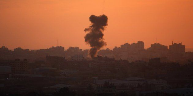 A picture taken from the Israeli Gaza border shows smoke billowing from the Gaza Strip following an Israeli...