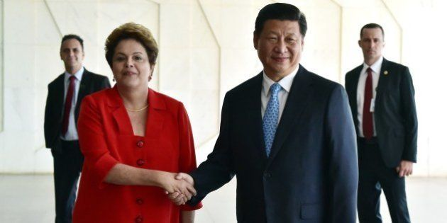 China's President Xi Jinping (R) is welcomed by his Brazilian counterpart Dilma Rousseff at Itamaraty...