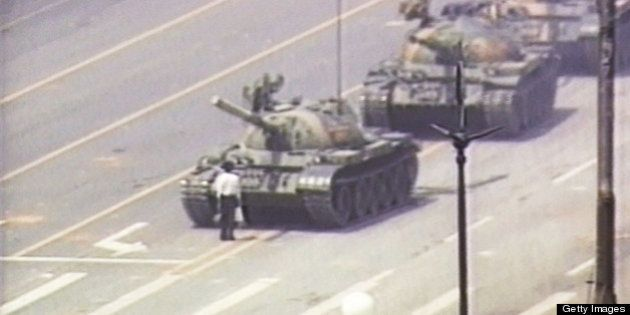BEIJING - JUNE 5, 1989: (JAPAN OUT) (VIDEO CAPTURE) A lone demonstrator stands down a column of tanks...