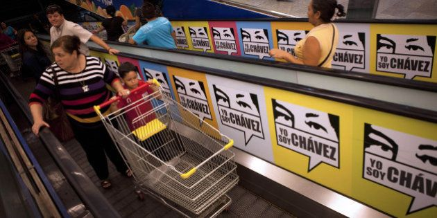 Consumers enter the state-owned Bicentenario supermarket in Caracas, on June 4, 2013. For almost a month...