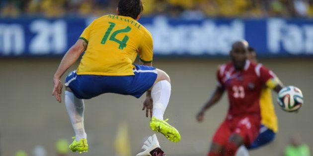 GOIANIA, BRAZIL - JUNE 03: Maxwell (#14) of Brazil and Goalkeeper Oscar McFarlane of Panama compete for...