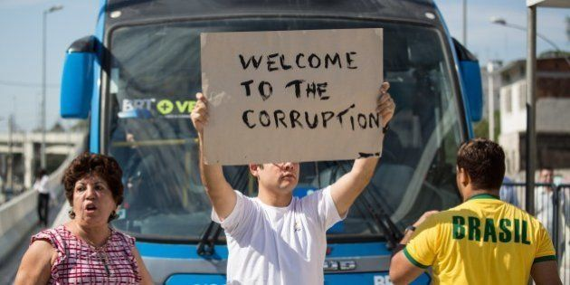 Residents protest during the inauguration of the BRT's new line, called Transcarioca, which connects...