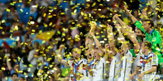 RIO DE JANEIRO, BRAZIL - JULY 13: Germany celebrate with the World Cup trophy after defeating Argentina...