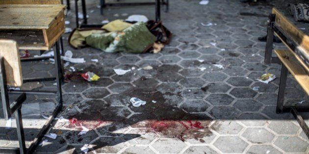 A trail of blood is seen in the courtyard of a UN School in the northern Beit Hanun district of the Gaza...