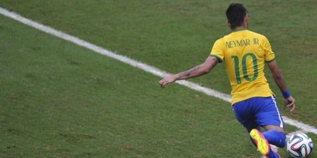 Brazil's Neymar runs with the ball during a friendly match against Serbia at Morumbi stadium in Sao Paulo,...