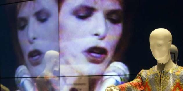 The Ziggy Stardust jumpsuit designed by Freddie Burretti (1972) is seen in front of a video installation...