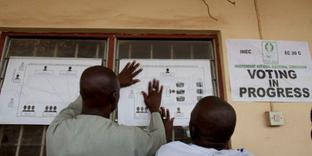 SATURDAY, MARCH 28- Kaduna Nigeria: Election officials post directions for the voting process at the...