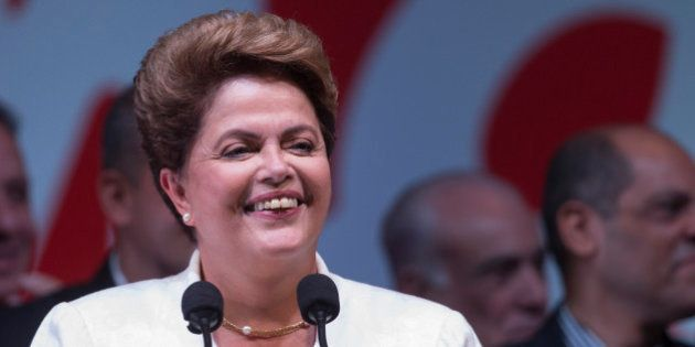 Brazil's President Dilma Rousseff gives her acceptance speech during a press conference at a hotel in...