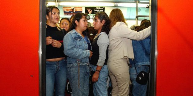Women stand inside a crowded train car in Mexico City, Mexico March 5, 2004. Due to high incidents of...