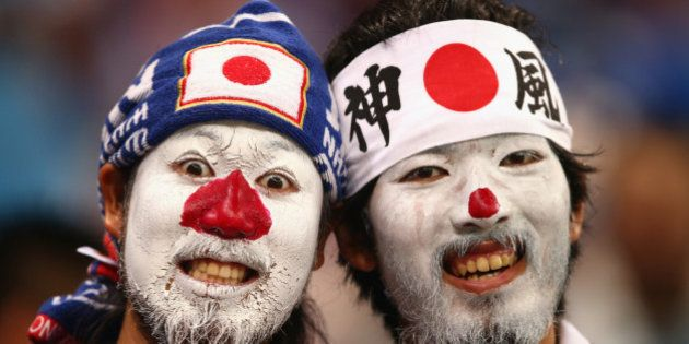 RECIFE, BRAZIL - JUNE 14: Japan fans look on during the 2014 FIFA World Cup Brazil Group C match between...