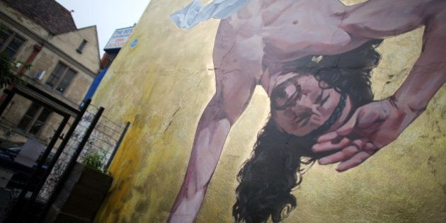 BRISTOL, ENGLAND - JUNE 11: Detail of artist Cosmo Sarson's mural of Jesus breakdancing that he has painted...
