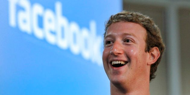 Mark Zuckerberg, founder and chief executive officer of Facebook Inc., smiles during a news conference...