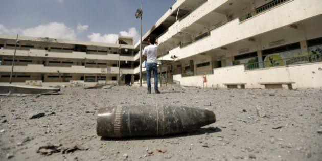 A shell lies on the ground at the heavily damaged Sobhi Abu Karsh school in Gaza City's al-Shejaea neighborhood...