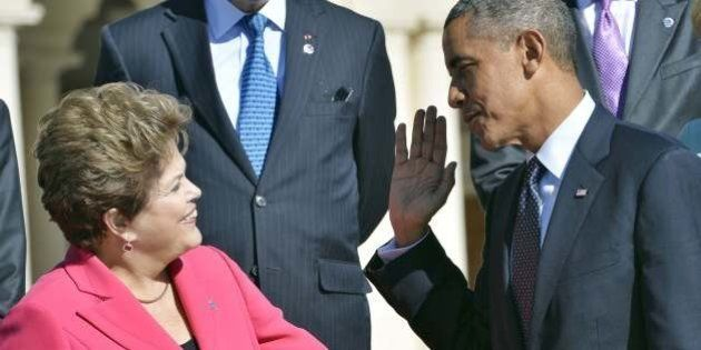 US President Barack Obama (R) greets Brazils President Dilma Rousseff as they arrive for the family photo...