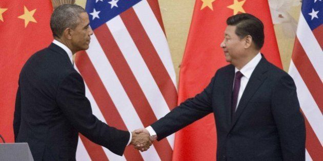 US President Barack Obama (L) and China's President Xi Jinping shake hands following a bilateral meeting...
