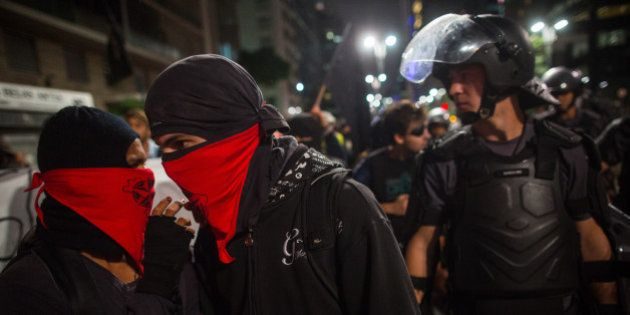 SAO PAULO, BRAZIL - NOVEMBER 5: Black Bloc demonstrators protest against the lack of water that is affecting...