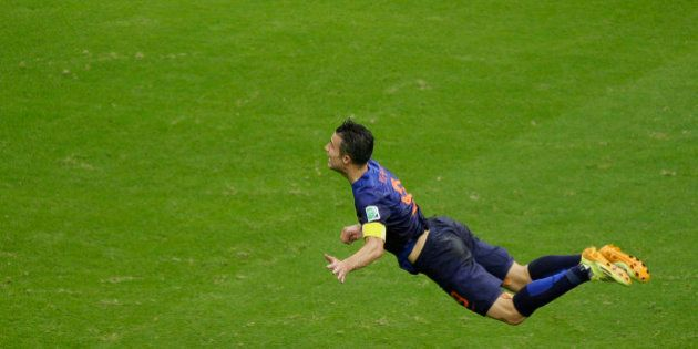 FILE - In this June 13, 2014 file photo, Netherlands' Robin van Persie heads the ball to score during...
