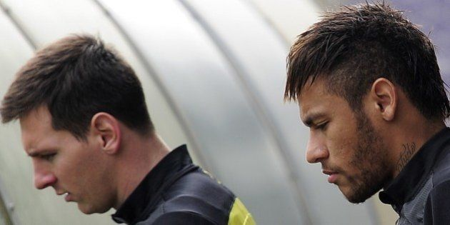 Barcelona's Argentinian forward Lionel Messi (L) and Barcelona's Brazilian forward Neymar da Silva Santos...