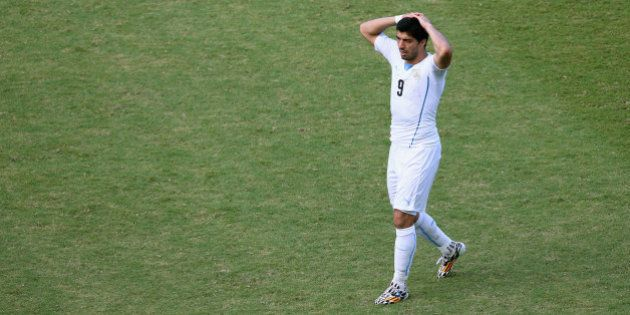 NATAL, BRAZIL - JUNE 24: Luis Suarez of Uruguay reacts during the 2014 FIFA World Cup Brazil Group D...