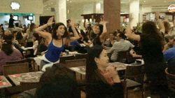 Era apenas um almoço comum... Até começar um Flash Mob na praça de