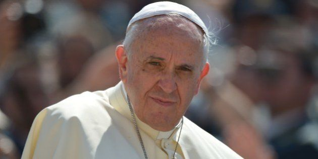 Pope Francis looks on during his general audience at St Peter's square on June 11, 2014 at the Vatican....