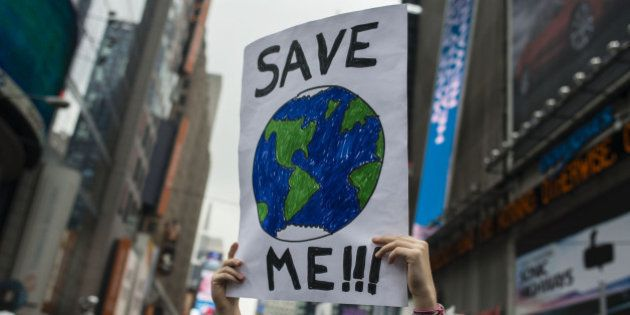 A demonstrator holds up a sign during the People's Climate March in New York, U.S., on Sunday, Sept....