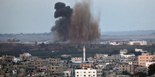 Smoke billows following an Israeli military strike on Gaza City on August 8, 2014. Israeli warplanes...