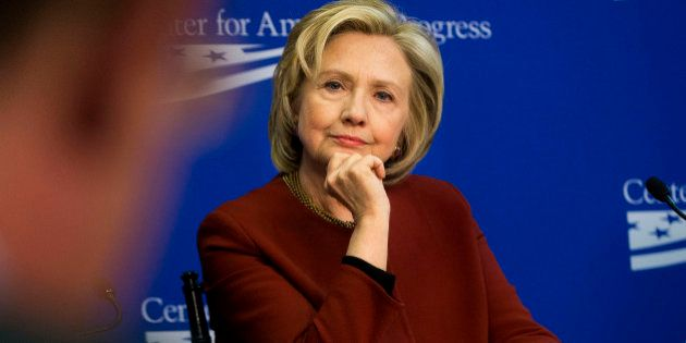 In this photo taken March 23, 2015, former Secretary of State Hillary Rodham Clinton listens during an...