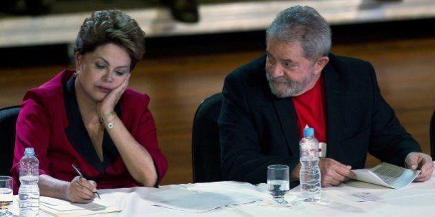 Brazilian President Dilma Rousseff (L) and former President Luiz Inacio Lula da Silva (R), attend the...