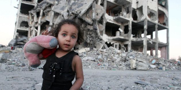 BEIT LAHIA, GAZA - AUGUST 12: A Palestinian girl is among the remains of buildings destroyed by Israeli...