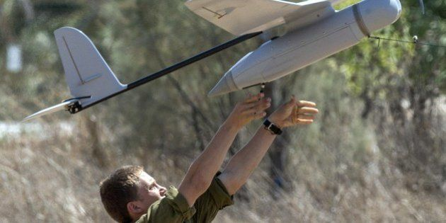 An Israel soldier prepares to launch an Israeli army's Skylark I unmanned drone aircraft, which is used...