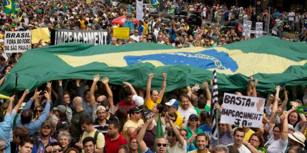 Demonstrators take part in a protest march demanding the impeachment of Brazil's President Dilma Rousseff,...
