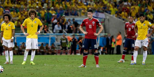 Colombia's James Rodriguez prepares to take the penalty kicks to score his side's first goal during the...