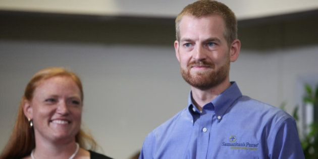 ATLANTA, GA - AUGUST 21: Dr. Kent Brantly (R), an Ebola patient at Emory Hospital, stands with his wife,...