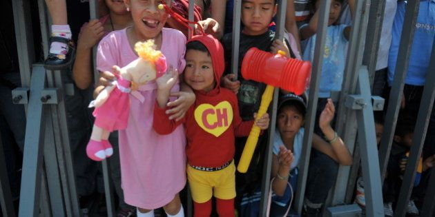 A child disguised as famous Latin American TV character 'El Chapulin Colorado' --starred by Mexican artist...