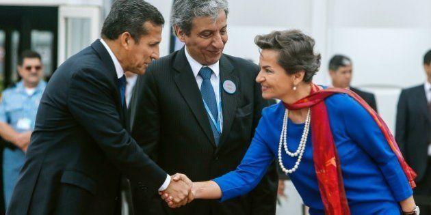 Peruvian President Ollanta Humala (L) shakes hands with UNFCCC Executive Secretary Christiana Figueres,...