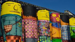 Dupla brasileira OsGêmeos transforma silos em gigantes coloridos no