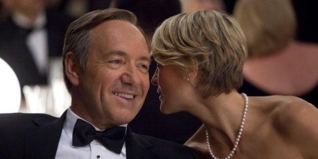 This image released by Netflix shows Kevin Spacey as U.S. Congressman Frank Underwood, left, and Robin...