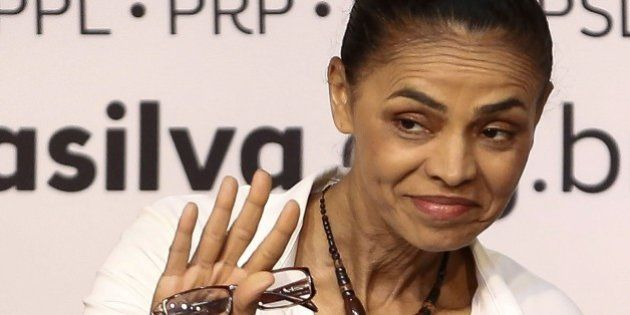 The presidential candidate of the Brazilian Socialist Party, Marina Silva (C) presents her project of...